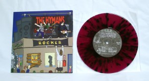 "The Hymans - Rocker (7"" vinyl, booze002, limited version, transparent purple vinyl with black splatter, 82 copies. 10 of those copies comes with Hymans and Bootleg Booze iron-on stickers)"