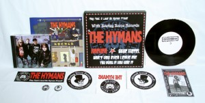 "The Hymans - Rocker (7"" vinyl, booze002, testpress, black vinyl in a screenprinted 3-color metal-box, 12 copies. + The Hymans sticker, The Hymans iron-on sticker, The Hymans 1"" pin, The Hymans ""Videoinsanity"" CD, Bootleg Booze Records sticker, Bootleg Booze Records iron-on sticker, Bootleg Booze Records 1"" pin, Flyer signed by The Hymans)"