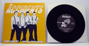 "The Accidents - Dead Guys (7"" black vinyl, booze015, european tour version with yellow sleeve, hand-numbered, 26 copies)"
