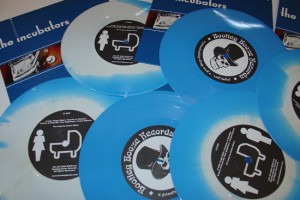 """The Incubators - Vision Express (7"""" vinyl, booze020, regular version, solid blue vinyl with white one-side-sunburst, no different boozersclub version of this 7"""", pile of vinyls, 500 copies)"""