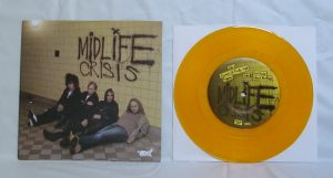 "Midlife Crisis - Cranked Up Really High (7"" vinyl, booze027, regular version, transparent yellow vinyl, 580 copies)"