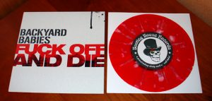 "Backyard Babies - Fuck Off And Die (7"" vinyl, booze029, regular version, transparent red with white splatter, 750 copies)"