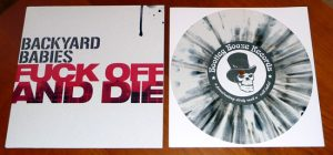 "Backyard Babies - Fuck Off And Die (7"" vinyl, booze029, second pressing, white vinyl with black splatter, 500 copies)"